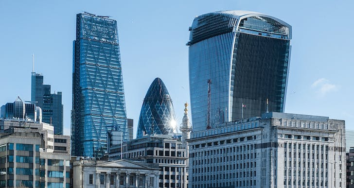 Fame and popular nicknames: Rafael Viñoly's 'Walkie Talkie' next to Norman Foster's 'Gherkin.' (photo via chtmag.com)