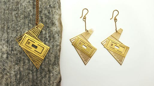 Pendant necklace and earrings of Bernard Tschumi's Acropolis Museum. Photo via QUPA/Etsy.