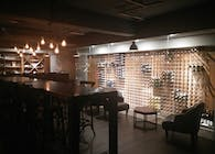 Old-world inspired glass encased wine cellar and tasting lounge.