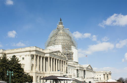 View of the United States Capitol building under renovation in 2015, Image courtesy of Wikimedia user Macieklew.