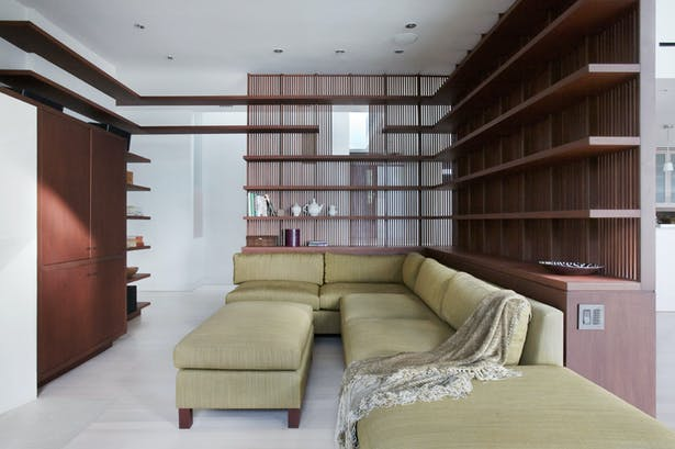 Mahogany shelves and screen form the library area