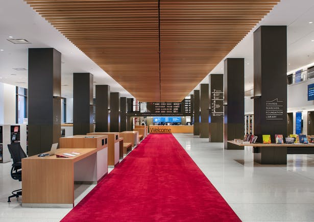SNFL's ground floor is arranged around an internal street that runs beneath a floating linear canopy of wood beams, from the Fifth Avenue entrance to the welcome desks. Image copyright by John Bartelstone