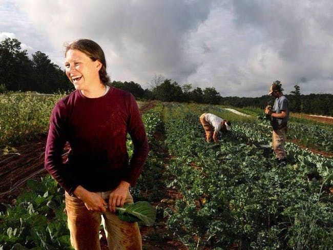 Paige Witherington is the farmer at Serenbe Farms, a 30-acre certified organic and biodynamic farm adjacent to a housing development outside Atlanta. It's one of more than 200 or so subdivisions with an agricultural twist nationwide. (Caption: NPR, photo: Serenbe)