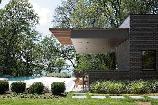 Modern Pool Cabana on Long Island with Architecture and Interiors by The Up Studio