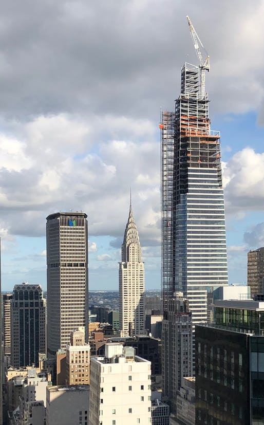 "View of the tower's crown under construction Image © New York YIMBY. ""One Vanderbilt Reaches Top Of Crown With Spire Installation Imminent, In Midtown East"" Used by permission; Photo by Michael Young."