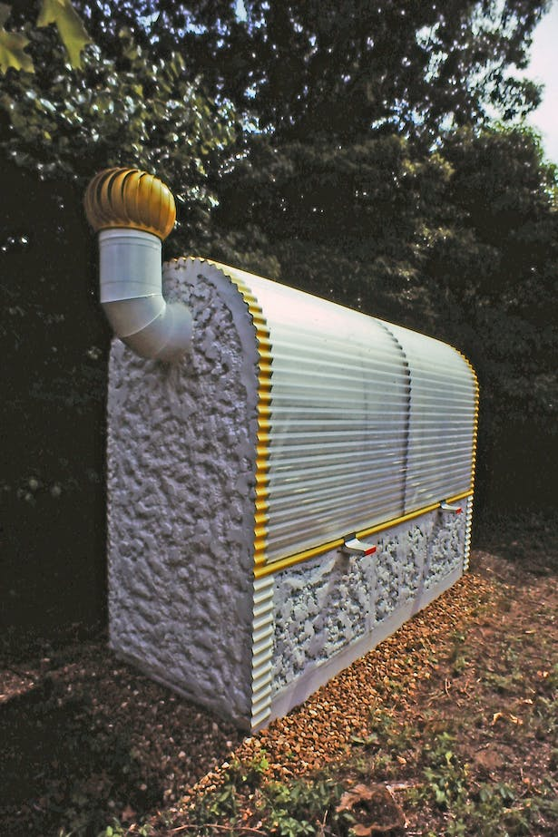 Solar heated insulated greenhouse, 1980.