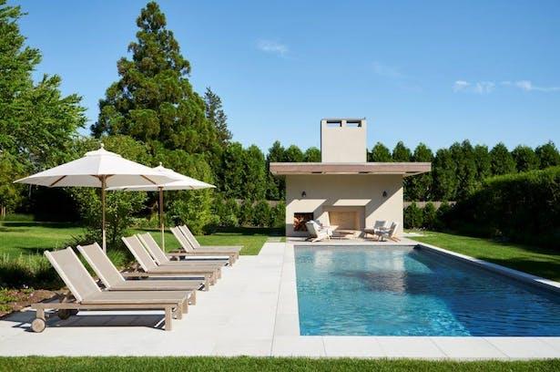 Stucco + mahogany pool house. Joshua McHugh Photography