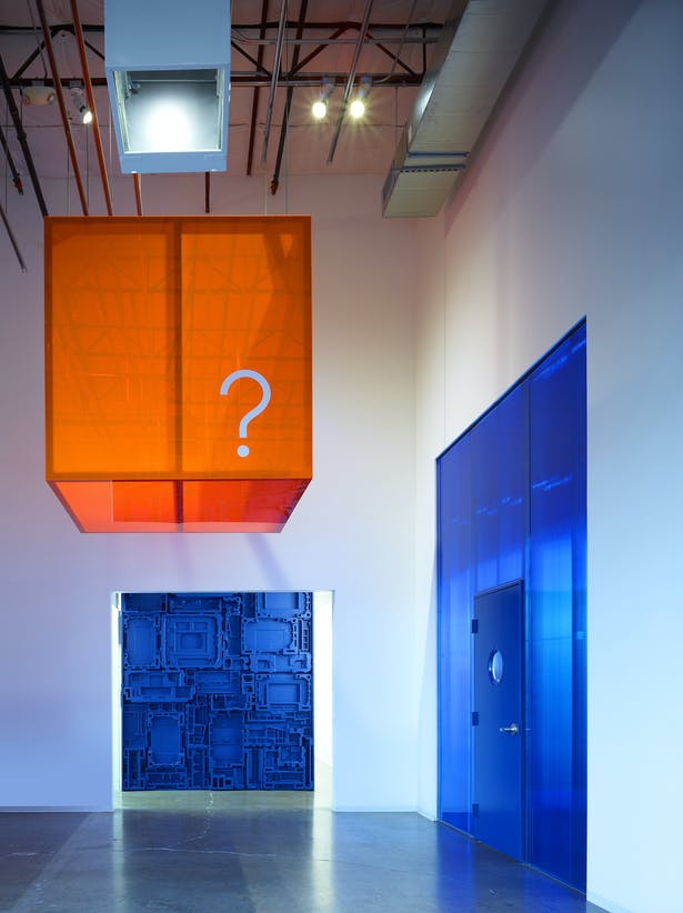 """The main lobby poses the question """"What will your solution be?"""" You start your journey with a question and finish with a solution. Repurposed formed foam panels are a greeting for the administrative offices and a statement to the company's commitment to recycling."""