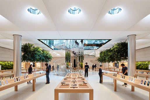 '18 mirror-glass Skylenses and 62 skylights flood natural light into the expanded store below the luminous glass cube.' - Photo courtesy of Apple