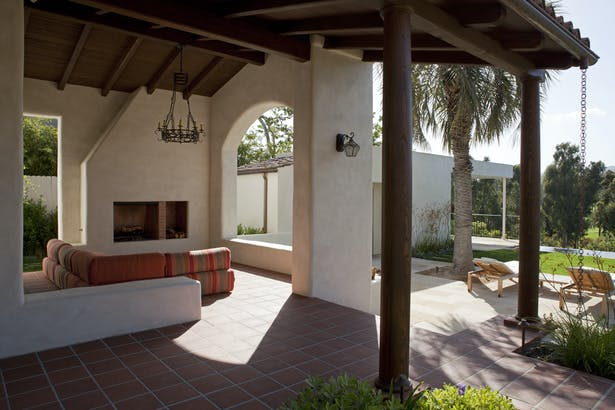 This covered outdoor patio area integrates the exterior and interior details.