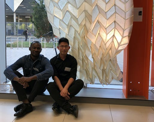 "Landscape architecture alums Jimi Demi-Ajayi and Julian Huang in front of the ""Phototropic Origami Fiber Composite Structure"" in London."