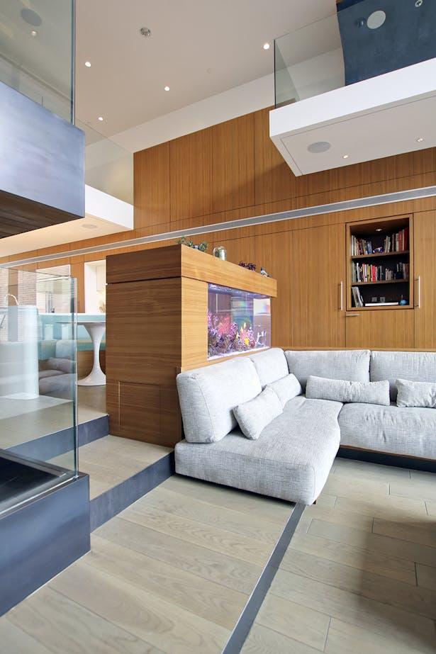 Black Steel and Teak Details at Sunken Living, Stair, and Built-In Aquarium