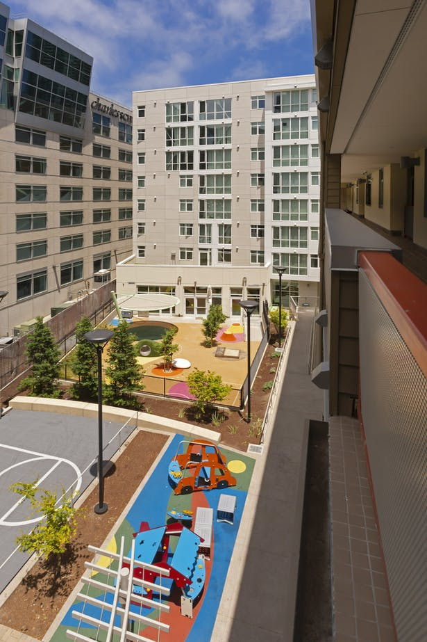 An mid-block courtyard provides a place for kids to play and families to gather. Photo © Michael O'Callahan