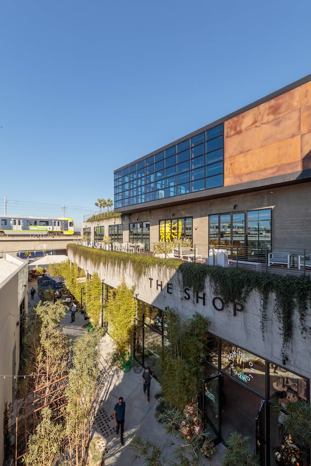 Traveling back towards the highly-trafficked street frontage, the elevated Greenhouse guides visitors into a grander community-scale.
