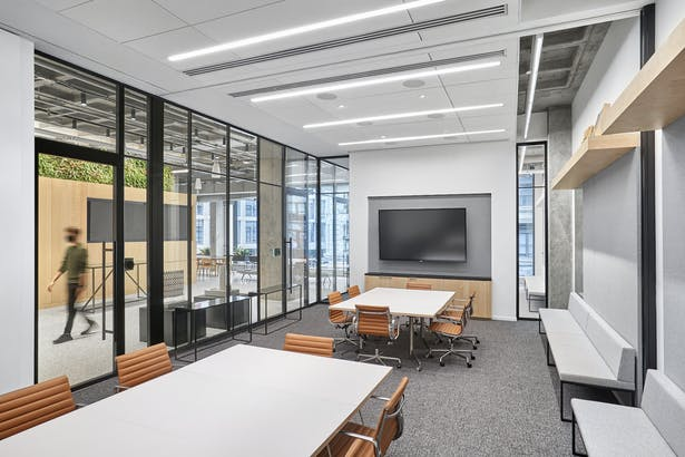 New meeting rooms reflect the 'new normal' of a post-COVID-19 world with robust IT/AV infrastructure to support hybrid in-person and at-home working formats. Photo Credit: Garrett Rowland