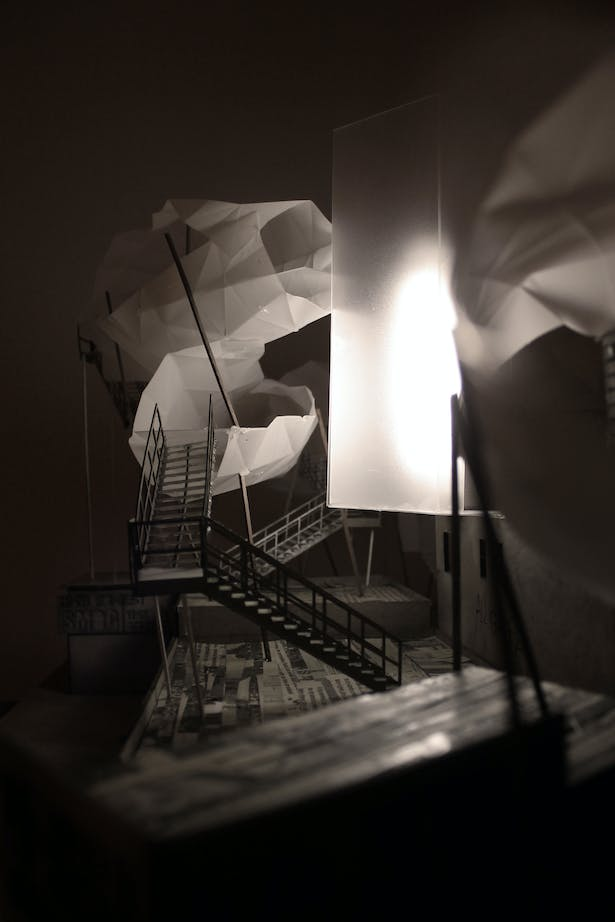 A view of the cloud forms which hover above the rooftops [photograph of physical model illuminated with LED lighting]
