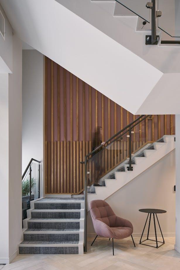 Bespoke feature wall alongside entrance lobby stair