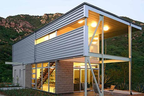 steel framed structure with metal cladding as modern minimal conceptual home