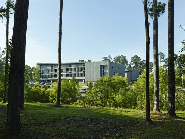 The complex is located is a wooded education and research campus. This is a view from the campus loop road.