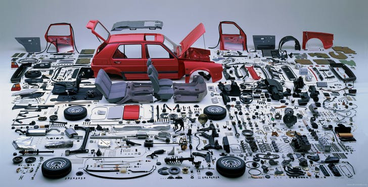 A dismantled VW Golf, ready to be put back together. Image by Hans Hansen, via twistedsifter.com