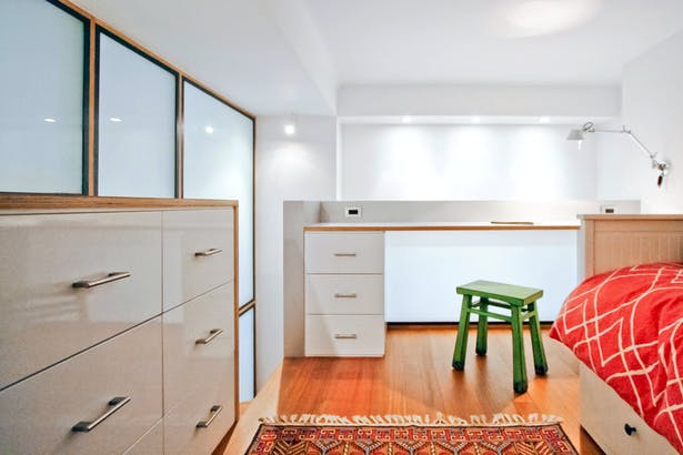 A Built-In Dresser and Desk Allows the Loft to Double as a Guest Bedroom and Homework Zone