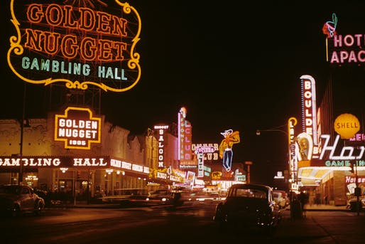 Fremont Street — at night in Downtown Las Vegas in 1952. With the former neon signs of the Golden Nugget Casino on the left, and neon Vegas Vic cowboy in distance. Image taken by Edward N. Edstrom. Courtesy of Gary B. Edstrom via Wiki Commons
