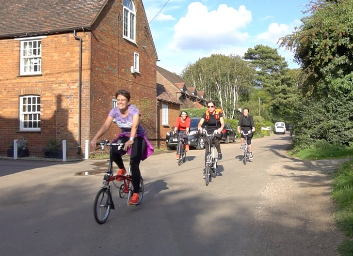 VeloCity team cycling through the village.