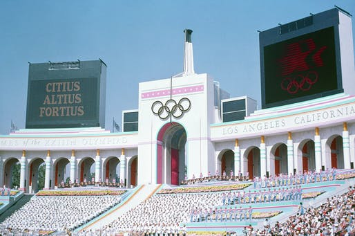 Los Angeles has agreed to host the 2028 Summer Olympics and plans on generating a surplus by reusing existing stadiums like the LA Coliseum, seen here during the opening ceremonies of the 1984 Summer Olympics. Image via Wikipedia.