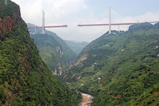 "Photo of the Beipanjiang Duge Bridge under construction in 2016. (Photo: Eric Sakowski; Image via <a href=""http://www.highestbridges.com/wiki/index.php?title=Beipanjiang_Bridge_Duge"" target=""_blank"">HighestBridges.com</a>)"