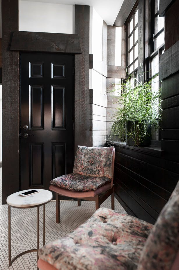 Within the lounge vintage library chairs were recovered in an opulent velvet with a heavy pattern. Marble occasional tables can be pulled up as needed. New white hex tile balances the heavy wood stain and ties into the existing flooring from the connection corridor beyond.