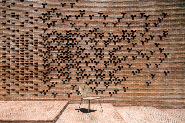 Brick walls designed to breathable and let the flesh air flow into the building.