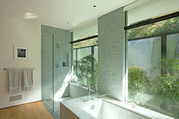 The master bathroom opens up to a private garden and ample light. A 'wet-zone' is denoted by mosaic marble.