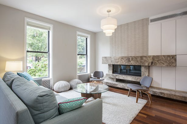 Custom fireplace and surround brings abandoned chimney back to life while providing warmth to living room