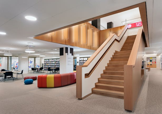 The Children's Library play area enjoys natural light, and the Teen Center has a dedicated staircase and study and media rooms. Image copyright by John Bartelstone