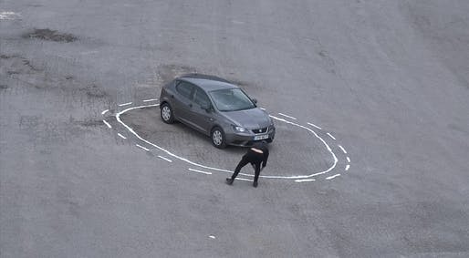 "James Bridle entraps a self-driving car in a ""magic"" salt circle. Image: Still from Vimeo, ""Autonomous Trap 001."""