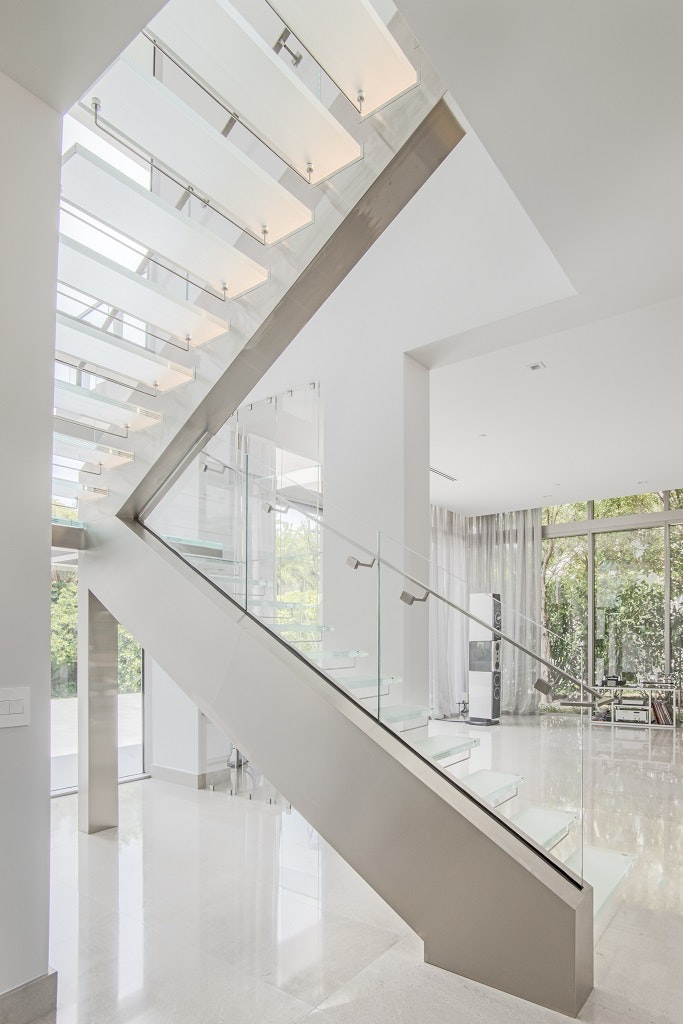 Our Cantilevered Design Features Frosted Glass Treads With LED Lighting  Installed Right Inside Of Them!