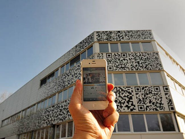 For budget reasons, the facade was extended and stickered with QR flashcodes. (Photo: MVRDV)