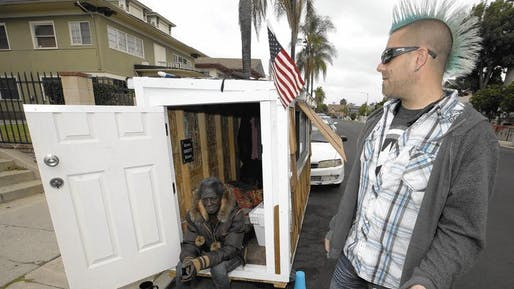 "Elvis Summers, right, with a tiny house on wheels he built for Irene ""Smokie"" McGhee. Photo by Damian Dovarganes / Associated Press."