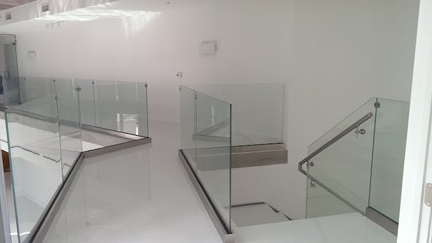 Clear Glass Railings Featuring Brushed Stainless Steel Elements