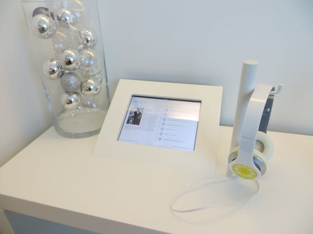 custom solid surface listening bar with integrated iPad holder