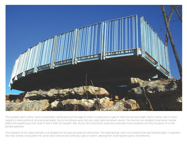 A construction photo showing the structure's prominent cantilever over the bluff.