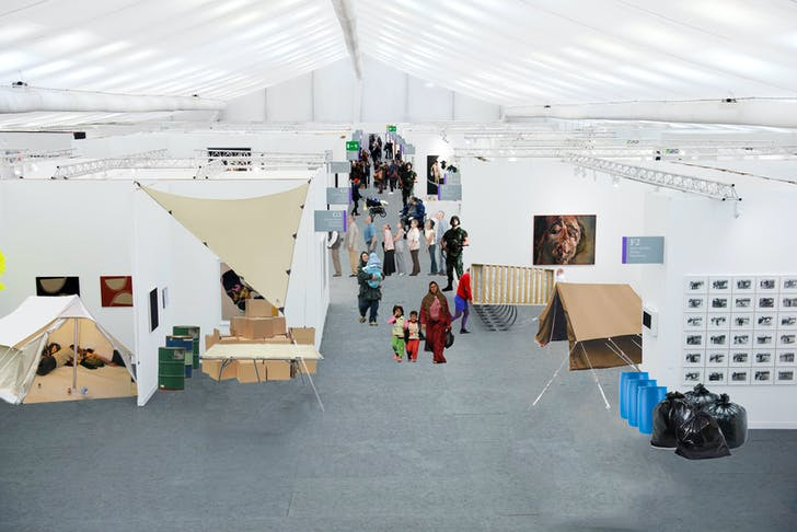 The architecture of the art fair is strikingly similar to that of a refugee campus with the addition of champagne bars, oil paintings, and consumer goods encased in lucite. Photo-collage by the author.