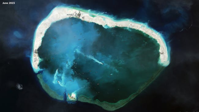 Several landmasses have been connected forming Mischief Reef, with a wide opening suggesting a possible future use as a naval base. Credit: CSIS Asia Maritime Transparency Initiative/DigitalGlobe via Washington Post