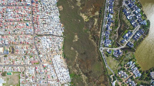 "Architecturally segregated communities Masiphumelele (left) and Lake Michelle (right) near Cape Town. Image from the drone photo series ""<a href=""http://www.unequalscenes.com/"">Unequal Scenes</a>"" by Johnny Miller."