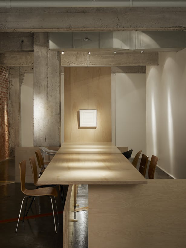 The Gallery seats a maximum of 10 surrounding a Baltic Birch slab table. The west end of the table is the focal point art for discussion.