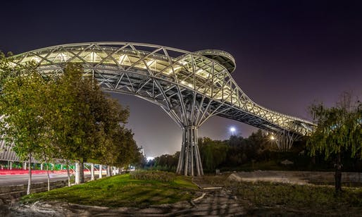 Tehran's new popular Tabiat bridge was designed by young architects Leila Araghian, Alireza Behzadi, and Sahar Yâsaei of Diba Tensile Architecture. (Photograph: Mohammad Hassan Ettefagh; Image via theguardian.com)