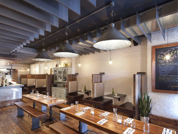 MOOBURGER - Dining room with steel ceiling fins & antique pendant lights