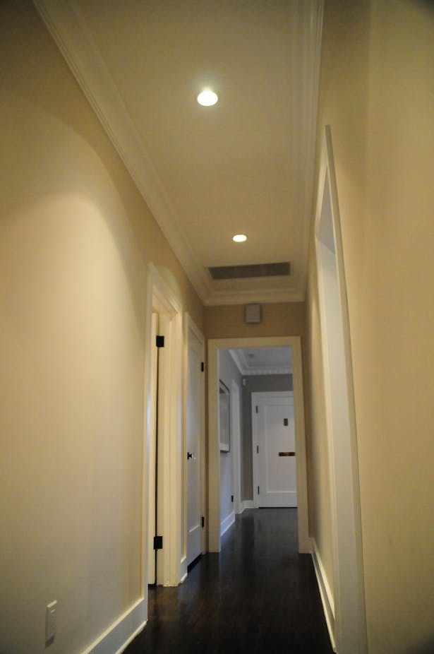 An unnecessary bend in the hallway was re-purposed for a new powder room.