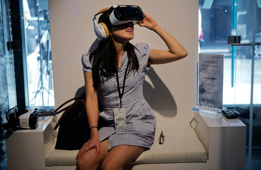 A woman wears Samsung's virtual-reality headset. Image from Bloomberg News, via wsj.com.