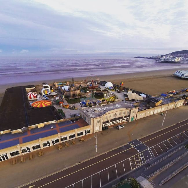 Aerial view of 'Dismaland,' the rumored Banksy pop-up show in the British seaside resort of Weston-Super-Mare. Photo: Iain Brimecome & Jon Goff, image via streetartnews.net.